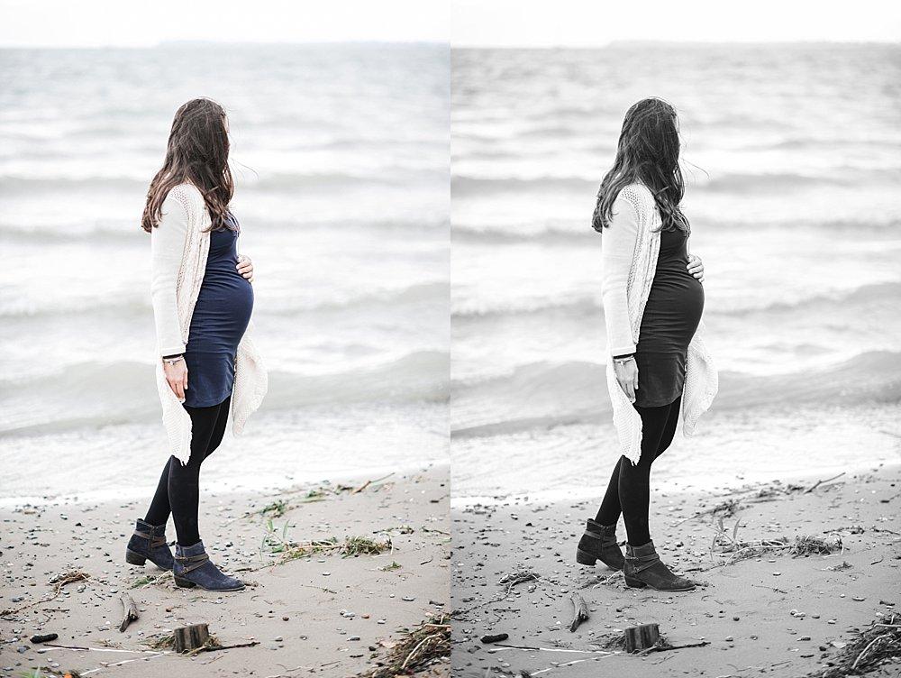 Schwangere Frau steht am Seeufer
